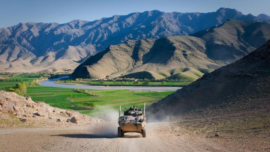 An Australian service light armored vehicle drives through Tangi Valley, Afghanistan