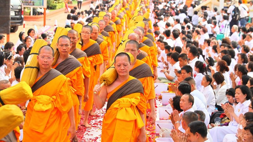 Buddhist monks praying during a ceremony