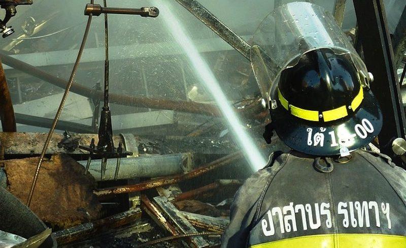 Thai firefighter spraying water