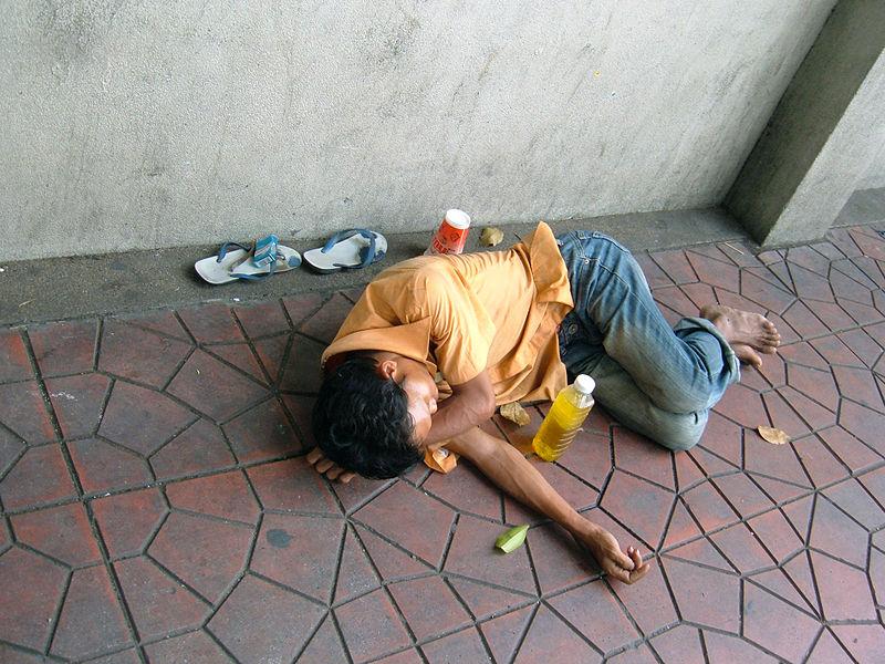 Homeless man sleeping in Bangkok