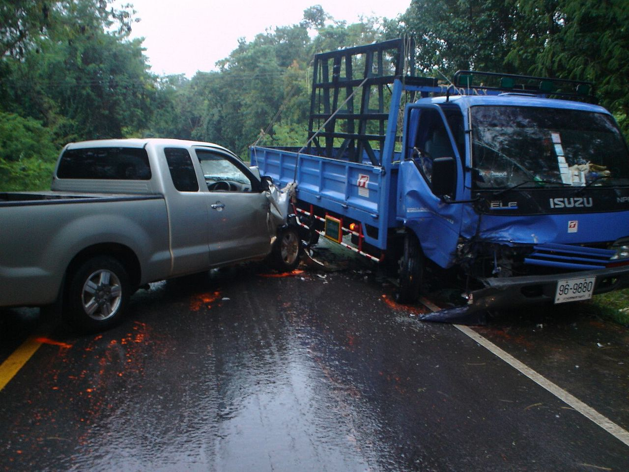 Pickup and blue truck crash