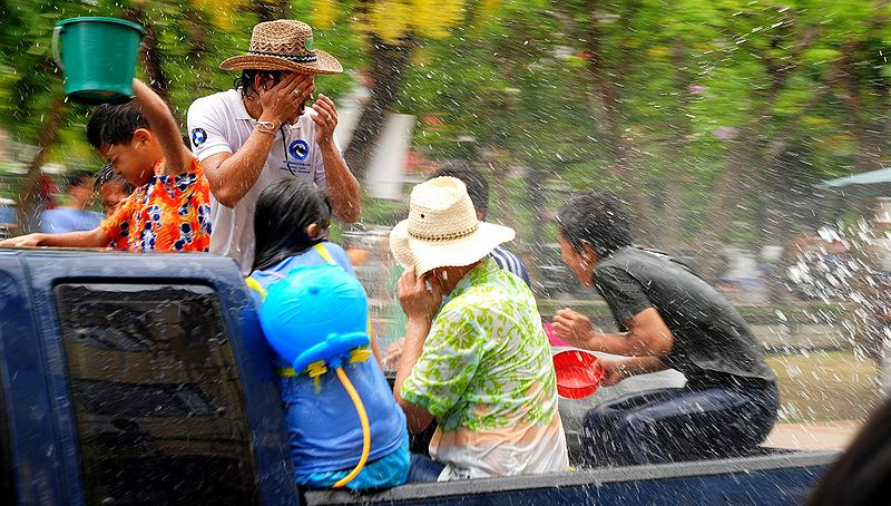People on the back of a truck during the Songkran festival in Chiang Mai