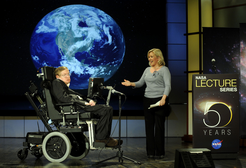 Stephen Hawking being presented by his daughter Lucy Hawking at the lecture he gave for NASA's 50th anniversary
