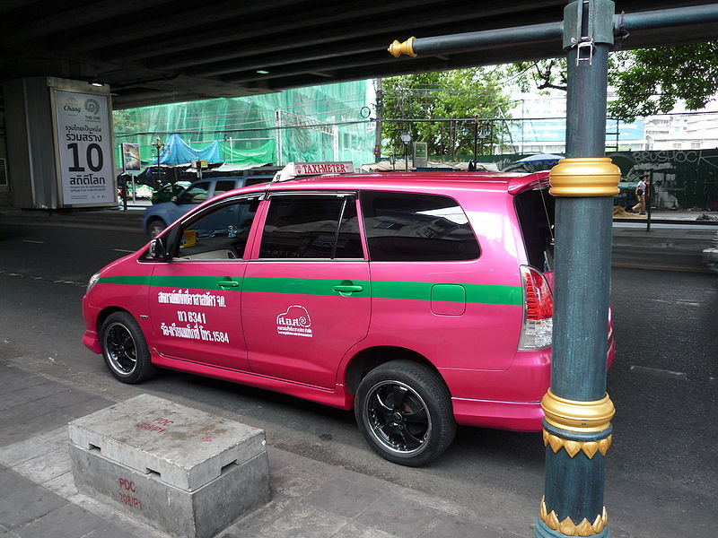 Pink taxi on Sukhumvit Road Bangkok