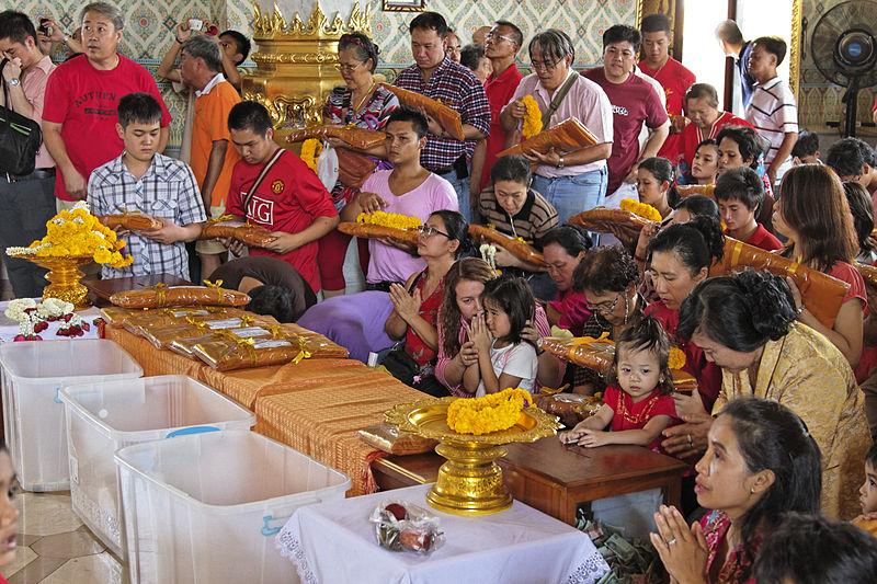 Thai Buddhists celebrating the Makha Bucha Day
