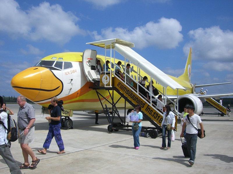 Passengers disembarking a Nok Air flight
