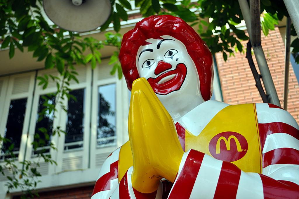 Thai Ronald McDonald greeting customers at McDonalds restaurant