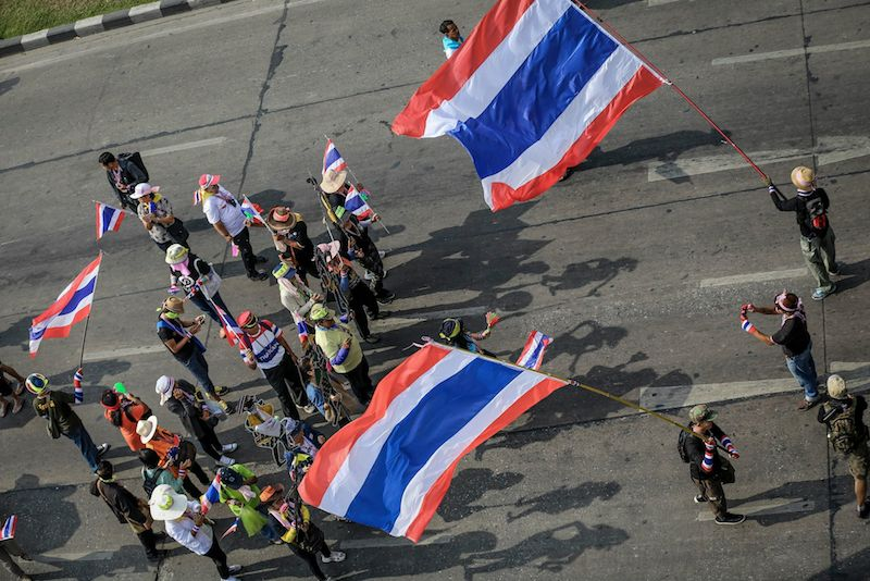 Protesters gather at Asoke Montri Intersection, block nearby roads