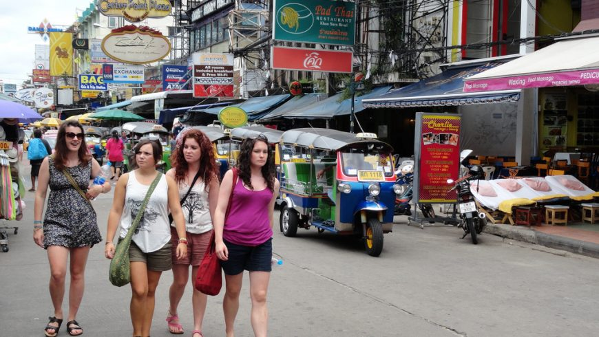 Four tourists on Khao San Road in Bangkok