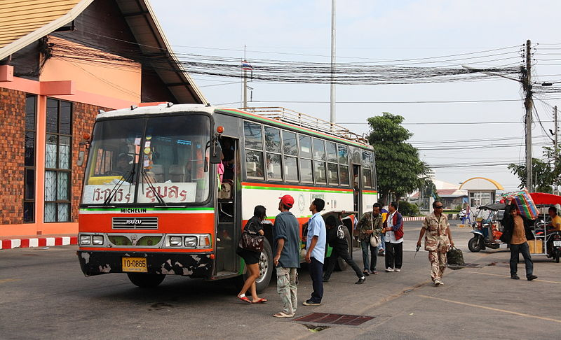 Isuzu bus and passengers at Ubon Ratchathani bus station