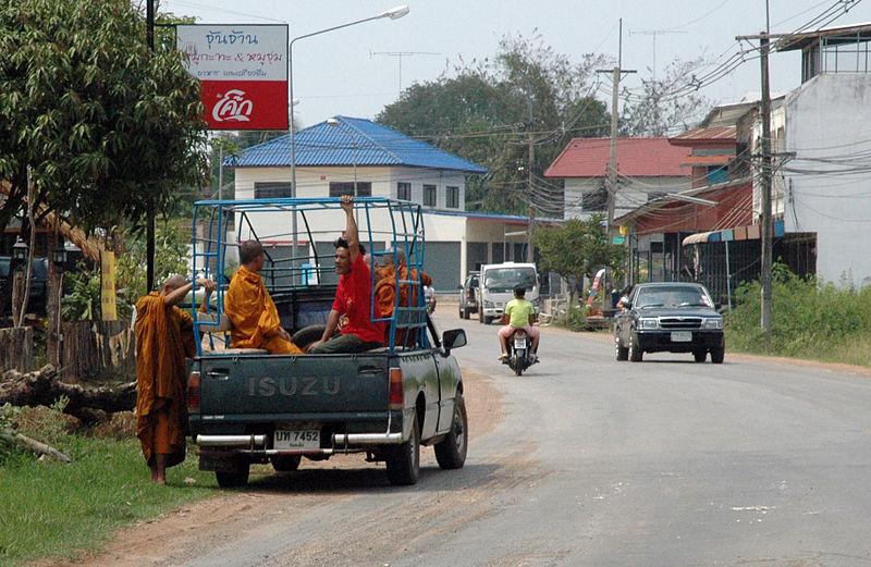 Monks boarding a pickup truck in Kalasin, Thailand