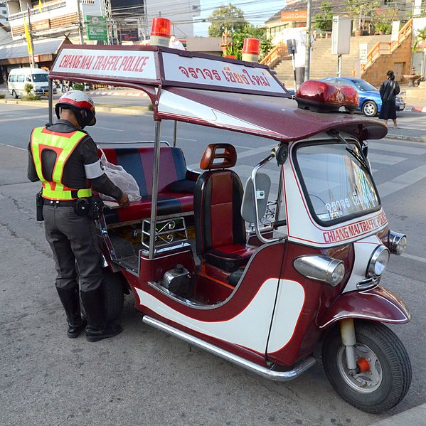 Thai traffic police tuk tuk