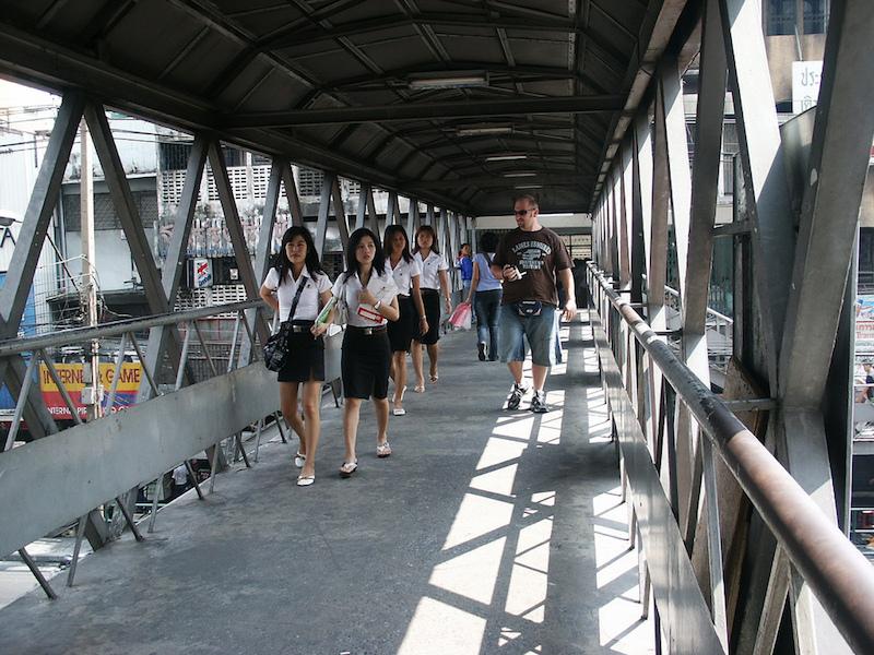 Thai schoolgirls at pedestrian overpass in Bangkok